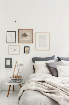 A neutral bedroom with gallery wall