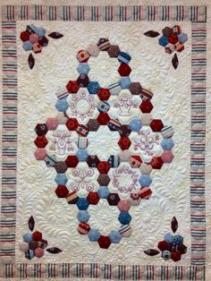 One Day at a Time designed by Sue Daley of Busy Fingers. It's pieced and custom quilted by www.thequiltbee.co