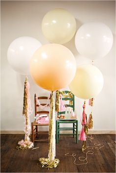 large balloons and tassels combined - love it for New Year parties in metallic colors