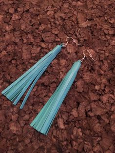 These are a gorgeous teal leather tassel earring. They hang at 4.5 and are mounted on silver nickel free hooks.