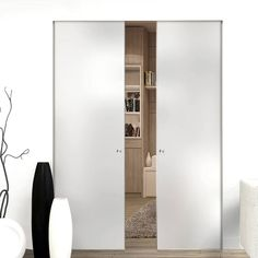 Eclisse 10mm Plain Satin Glass Syntesis Double Pocket Door - No Design.    #frostedglassdoors #doubleglassdoors #framelessglassdoors #interiorglassdoors #directdoors