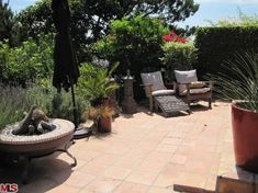 Backyard Patio... The backyard patio of Ryan Reynolds' Hollywood Hills home, featuring a tiled floor and an outdoor firepit.