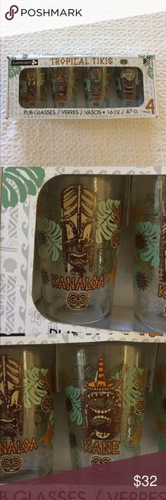 Tropical Tiki Pub Glasses Set of 5 These pub glasses are new in the box and have never been removed from the original packaging. Four beautifully decorated Tropical Tiki Glasses by Luminarc, featuring Kanaloa (God of the se and all things on earth) Kane (God of the universe) Lono (God of fertility and a Diety for music) Ku-Ancient (Tiki God of war). Made in USA. Luminarc Other
