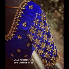 Best 12 Stunning blue color designer blouse with floral design hand embroidery kundan and bead work. Indian Blouse Designs, Blouse Back Neck Designs, Cutwork Blouse Designs, Hand Work Blouse Design, Simple Blouse Designs, Stylish Blouse Design, Bridal Blouse Designs, Sari Design, Floral Design
