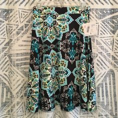 Gorgeous Lularoe Azure Skirt New with tags Azure skirt by Lularoe. 96% polyester, 4% spandex for a great soft feel with good stretch and movement. LuLaRoe Skirts Midi