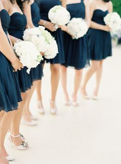 Short navy blue bridesmaid dresses with all-white bouquets.  #Navy #Blue #wedding
