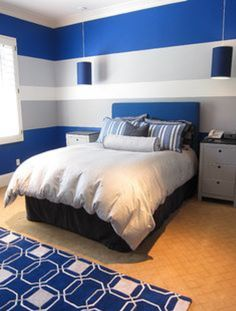 Oh my, there isn't anything I don't love about this room (besides the awful yellow floor), love the striped white, cobalt blue and white walls, the lights, gray nightstands, geometric blue and white rug and the comforter set!