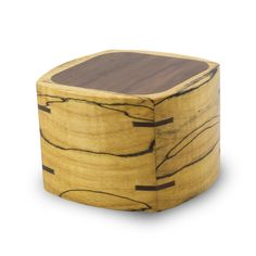 - Exceptional hand carved wood cremation keepsake box with rounded edges and a walnut top. - Hand made in the USA. - Each cremation urn has natural variations in color and pattern. - Storage compartme