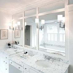 Gorgeous bathroom with double white built-in vanity paired with polished nickel hardware and marble countertops with a drop-down make -up vanity. Master Bathroom Vanity, Bathroom With Makeup Vanity, White Bathroom, Modern Bathroom, Bathroom Vanities, Master Bathrooms, Beautiful Bathrooms, Bathrooms Online, Tiled Bathrooms