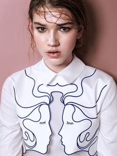 Embroidered faces on blouse