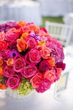 bright colors - green hydrangea with pink, red, orange and purple roses and mixed flowers, add some peach and cream peonies instead of purple and I am in love!!!