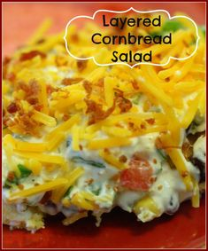 Layered Cornbread Salad - 1 box honey cornbread mixed w/ 4.5 oz chilies, 1 ranch pkt mixed w/ 8 oz sour cream and 1c mayo, 2 cans beans drained and rinsed, 1/2 green pep diced fine, 1/4 onion diced fine, tomatoes, 1 can sweet corn drained, 2c sharp cheddar.