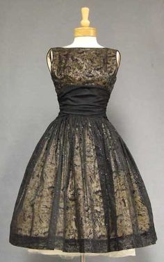 A fabulous late 1950's/early 1960's cocktail dress in black nylon chiffon flocked with a pattern of dancers and topped with a subtle hint of glitter.