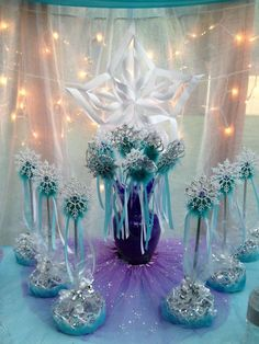 princess wands & tiaras; tutu around bottom of vase; purple feather filler for vase
