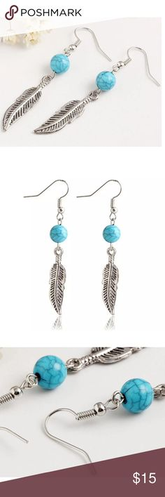 SALE! Beautiful Earrings w/ Feather & Bead Detail These stunning earrings feature a turquoise colored bead and antique silver finish. The Feather adds a whimsical and trendy element to these super cute earrings! Limited Quantities! Jewelry Earrings