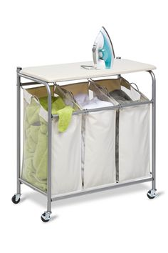 Smart Spaced Saver - It's an ironing board and & Sorter Laundry Center in one. I need this.   Nordstrom Rack  Sponsored by Nordstrom Rack.