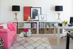 Gorgeous interior design inspiration.  Pink couch, cute table, pattern rug.