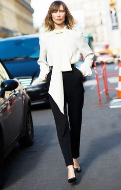 White blouse with a neck tie, black trousers, and black heels