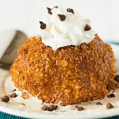 Fried Ice Cream Recipe | Brown Eyed Baker ~ The outside is warm and crunchy, then once you break through the crust there's cold, creamy vanilla ice cream waiting for you. A deliciously perfect complement of flavors and textures.