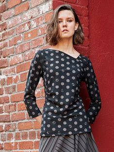 Porto's Chariot Top features truffle brown polka dots on a black base, angled neckline, a tuck at one side of the waist, and 3/4 length sleeves. Made from microfiber jet jersey from Italy- a washable, stretch fabric that is extremely comfortable and wrinkle resistant. Truffle, Stretch Fabric, Jet, Polka Dots, Neckline, Italy, Base, Boutique, Brown