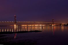 side view bridge at night with light reflections | Forth Road Bridge at night