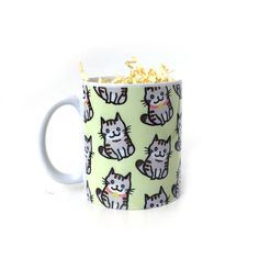 Cute Cat Pattern Ceramic Mug Available in 2 different sizes: 6 oz (coffee/tea mug) or 11 oz (standard size mug) Please note that there may be slight color differences between the product picture and t
