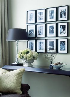 Photo wall - so simple and clean. Frames almost touch. More space between rows than between each frame.