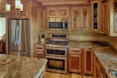 What countertops go with hickory cabinets google search for Wide open spaces cabin broken bow