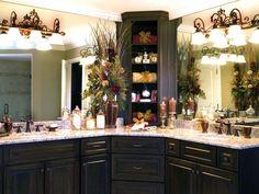tan bathroom,espresso cabinets,granite mocha top,ornate vanity lights and flower treatment...add feathers..