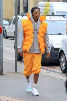 ASAP Rocky wearing Balenciaga Inflatable Jacket, Gucci Logo Hoodie, Nike Custom Air Force 1 By Trevor Andrew