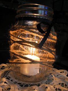 pasta sauce jar + ribbon + twine + candle = awesome! (also works with lace)