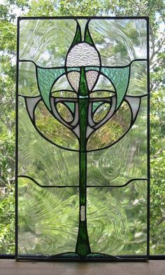 I believe that green is a neutral color.  I love the grey here.  My taupe would be nice in this combination of colors.  Art Deco Stained Glass Window