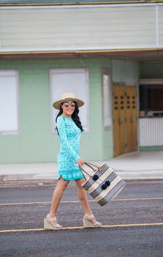 How pretty is Len Parent in our Monaco Blue Zip Shoulder Dress?! We love her hat, wedges, and awesome bag too! Cabana Life 50+ UPV Sun Protective Clothing