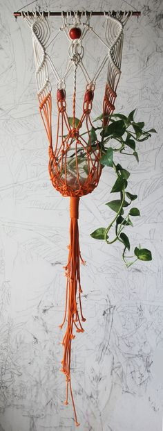 Handmade and dyed macrame plant hanger. Oak dowel 13 1/2 wide, planter aprox. 46 long, holds a 5 round pot or vase. Vase not included
