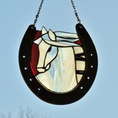 White Horse on Red Background Stained Glass Horseshoe Suncatcher created by Janice Finn Culp. www.shimmeringmesaglass.com