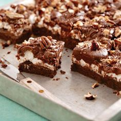Mississippi Mud Cake is a classic Southern sheet cake filled with marshmallows and chopped pecans and covered in a rich chocolate frosting. This particular recipe offers a cupcake variation as well as a shortcut version.