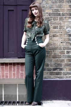 Love the high waisted buttoned trousers. Looks really chic with the pussy-bow blouse