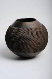african ceramic - Google-haku In most cases, pottery was made by women. Clay was worked on entirely by hand and shaped and fashioned into the desired shape. In other cases, the women would pour the clay into a mould made of pottery, wood or a calabash. Clay pots were and still are being used to cook food, store water and for various other food preparation functions.
