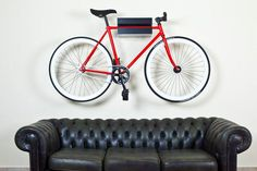 red, black, and white fixie on the wall