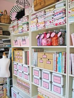 Nice use of shelving and storage boxes for supplies in this sweet #sewing #room. #organization