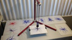 A graphic art drawing machine which uses a pendulum to create crazy random drawings. Built with Anodized Aluminum in the USA.