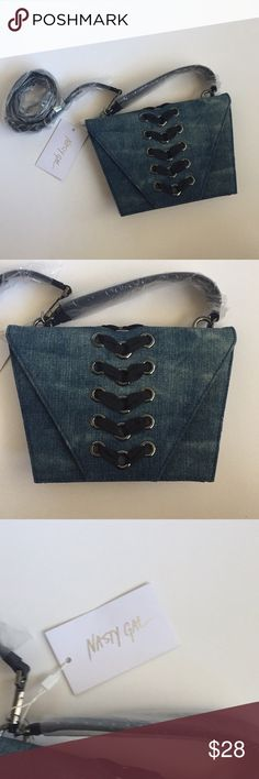 """Dark blue denim laced purse bag by Nasty Gal Casual, unique denim bag that can be held by the studded handle or put over your shoulder with the solid black long strap. Strap is removable. Dark chrome hardware.   One original tag still attached. By Nasty Gal.  10.5"""" x 7.5"""" x 2.5"""" Nasty Gal Bags Crossbody Bags"""