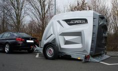 BikeBox 24 - Motorcycle Garage - BikeBox 24 Trailer - The bikeBOX24 XL Trailer - a technical highlight.  About an axis of rotation of the whole platform is lowered. The bike box can thus be easily mounted on the trailer