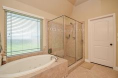 1735 Callaway Cove Ct Rosenberg, TX 77471: Photo A separate seamless walk in shower. A large closet, beautiful natural light and an amazing garden tub in the master spa.