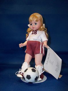 Madame Alexander Collection Item This little girl will make you proud with her great sportsmanship and soccer skills! She is adorable with her soccer uniform, shin guards, and blonde pigtails! Soccer Uniforms, Soccer Skills, Girls Soccer, Madame Alexander Dolls, Blond, Little Girls, Harry Potter, Disney Princess, Disney Characters
