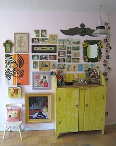wall collage... I especially love the polaroid pinned to the lamp cable