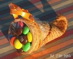 Cute idea for thanksgiving treat...waffle cone filled with M&M's :) Here'a how to do it ... Take a sugar waffle cone dip the tip in warm water for 20 seconds then microwave 20 seconds, next using a pencil roll the moistened end around the pencil & hold for 20 seconds...there you have it & fill with any little treat you'd like
