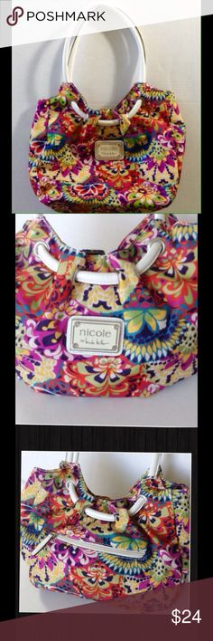 Nicole Miller Colorful Floral Shoulder Bag This is a darling handbag with tons of room.  Works with any color scheme.  12 inches across.  Top of strap to bottom of bag is 18 inches.  Magnetic closure.  4 interior pockets, one with zipper.  Almost too cute to sell!  In excellent pre-loved condition! Nicole Miller Bags Shoulder Bags