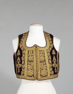 Vest Date: 1880–1900 Culture: Albanian Medium: silk, metal, cotton, wool Dimensions: Length at CB: 15 1/2 in. (39.4 cm) Credit Line: Brooklyn Museum Costume Collection at The Metropolitan Museum of Art