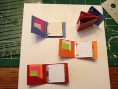 DIY miniature binder.  This is adorable!  Personally, though, I would make mine a 3 ring binder as most loose leaf binders like this are three rings.  Just add a 3rd jump ring to the center.